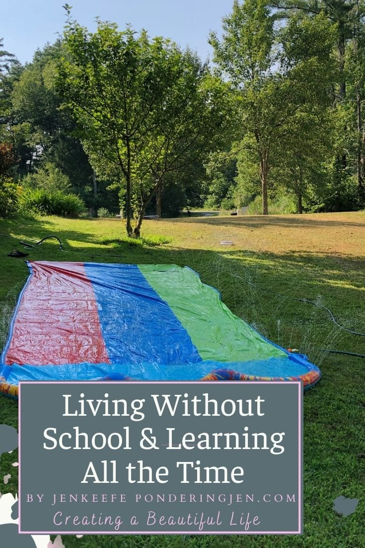 image of slip and slide with text living without school and learning all the time