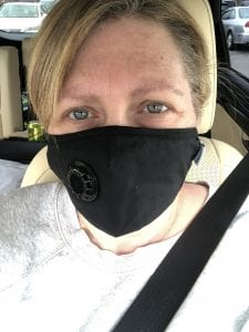picture of calm woman wearing mask