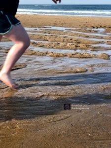 child running at beach